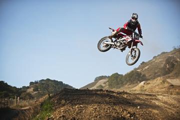 Motorbike racer in the air.