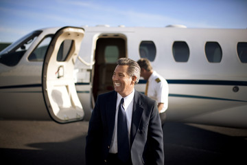 A businessman leaving a plane at the airport