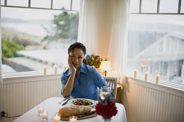 Mature woman alone at dinner time