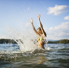 Young woman splashing water.