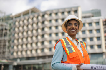 Portrait of a smiling businesswoman on a construction site.