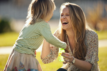 Woman playing with her young daughter.