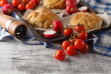 homemade italian olive bread on grid