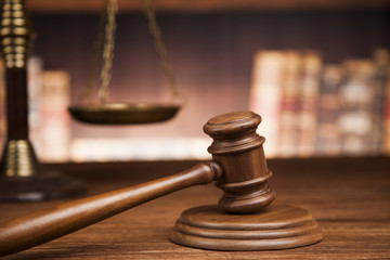law theme, mallet of the judge, justice scale, books, wooden des