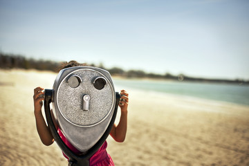 Young girl with coin operated binoculars.