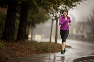 Young woman jogging on a residential street.