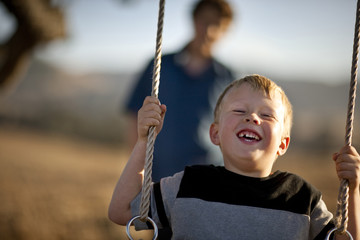 Small boy on swing.
