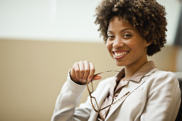 Portrait of businesswoman sitting and smiling.