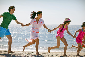 Family enjoying time at beach.