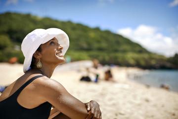 Woman sitting on beach.