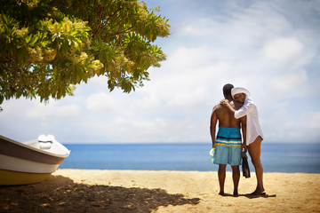 Couple standing on beach.