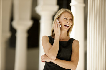 Businesswoman excitedly talking on her cellphone.