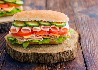 Turkey Ham Sandwich With Cheese, Tomatoes, Cucumbers and Salad
