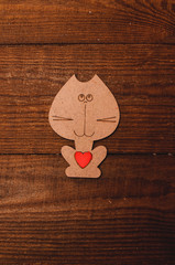 wooden cat with red heart