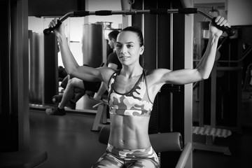 Young woman training in gym. Black and white photo