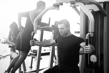 Young man training in gym. Black and white photo