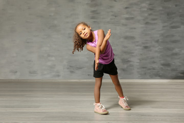 Cute African American girl in dance studio