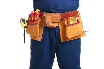 Electrician with special tools on white background, closeup