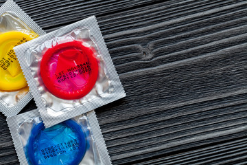 concept male contraception condom on wooden background top view