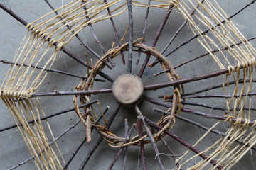 Natural wood, vines, and twine art construction web