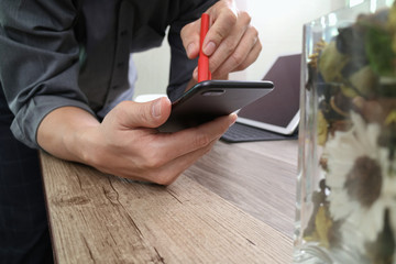 businessman hand with pen using smart phone,mobile payments onli
