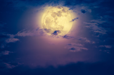 Nighttime sky with clouds and bright full moon. Vintage effect tone