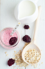 blackberry smoothies and ingredients on a white background