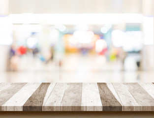 Wood table top with shopping store bokeh light background,Mock u