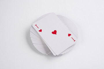 Close up of playing cards poker game with ace of hearts on white background