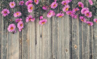 Photo autumn chrysanthemum on rustic wooden background retro styled