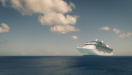 Cruise liner on blue ocean.