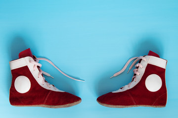 Leather shoes are to fight on a blue background