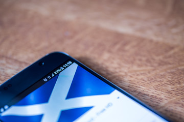 4G Smartphone with 25 percent charge and Scotland flag