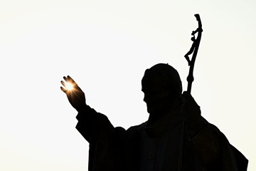 Printed roller blinds Historic monument Silhouette of statue of pope John Paul The Second with afternoon sun in his palm, castle Nitra, Slovakia