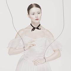 ballet dancer as puppet dancing over white background