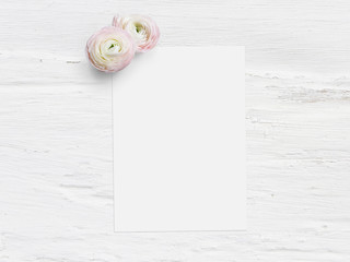 Styled stock photo. Feminine digital product mockup with uttercup flowers, Ranunculus, blank list of paper and shabby white background. Flat lay, top view. Picture for blog or social media.