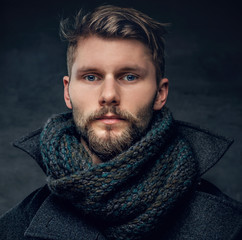 A man in a jacket and scarf.
