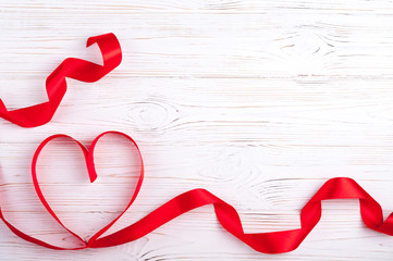 Valentines Day background with red heart. Heart shape from ribbons. Top view. Copy space