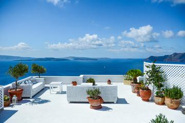 Comfortable sofa on the balcony with view of Santorini