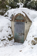The heavy steel door of the snowy bomb shelter during the Cold War
