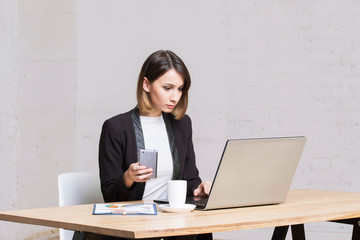 Business woman answers the office smartphone call work.