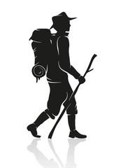 Silhouette eines Wanderers mit Rucksack und Wanderstock