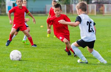 Boys kicking ball