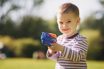 little boy with water gun