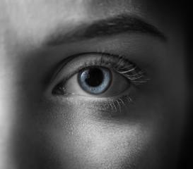 Blue iris eye over black and white. Macro shot.