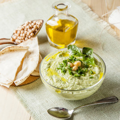 Bowl of green hummus,delicious cream of chickpeas and basil