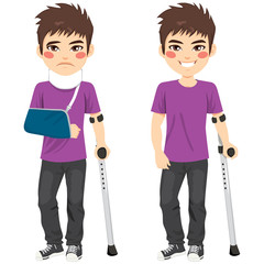 Cute teenager boy injured with crutches and bandaged arm