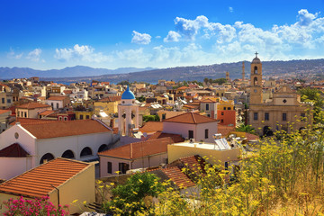 Top view of the city of Chania. Greece, island Crete. City landscape. Small city view. Tiled roofs against the sky with clouds.