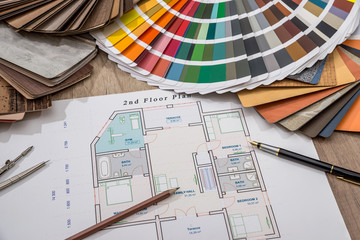 Fototapeta architectural drawings with palette of colors and wooden sampler for furniture designs for interior works. obraz