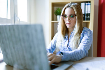 Young businesswoman working at home with a laptop